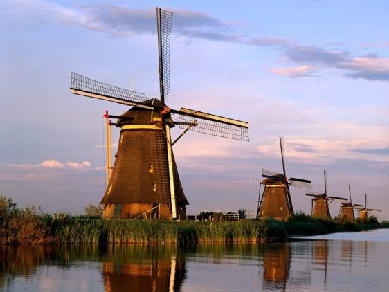 Eighteenth century windmills, once used to drain Holland's fenlands (a type of marsh), are now a UNESCO World Heritage Site in the village of Kinderdijk, the Netherlands.
