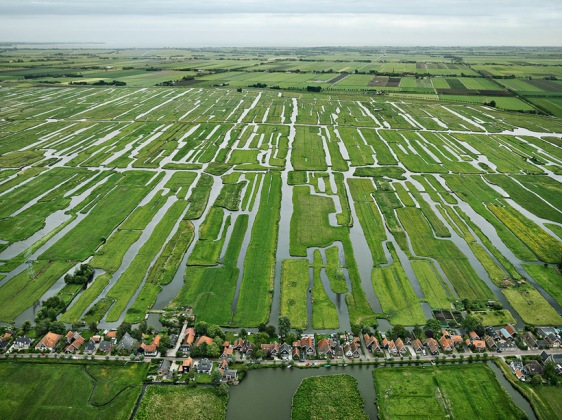 An array of polders and dikes in the countryside of Grootschermer, the Netherlands. Image by Edward Burtynsky.